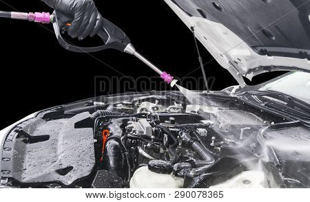 Car Detailing. Manual Car Wash Engine With Pressure Water. Washing Car Engine With Water Nozzle. Car