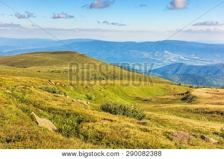 Beautiful Summer Landscape In Mountain. Alpine Meadows In Evening Light. Ridge And Valley In The Dis