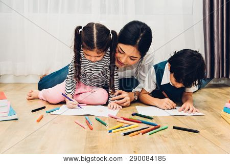 Happy Child Kid Boy And Girl Son Kindergarten Drawing On Peper Teacher Education With Beautiful Moth