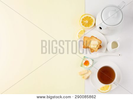 Breakfast Table With Soft Boiled Egg, Crispy Toasts And Cup Tea On Whiite Yellow Background, Top Vie