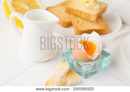 Breakfast Table With Soft Boiled Egg, Crispy Toasts And Cup Tea On Whiite Background, Selective Focu