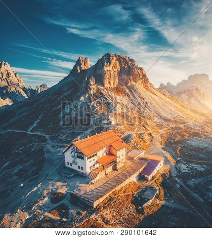 Mountain Valley With Beautiful House And Church At Sunset In Autumn. Landscape With Buildings, High