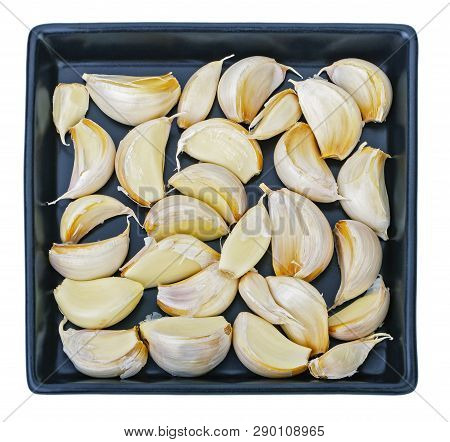 Raw Garlic And Garlic Cloves On Balck Dish On White Background
