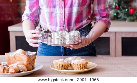 Pastry Dessert Assortment. Female Hobby And Lifestyle. Woman Arranging Plates With Fresh Homemade Me