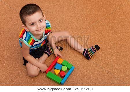 Cheerful Boy Building A Block Garage