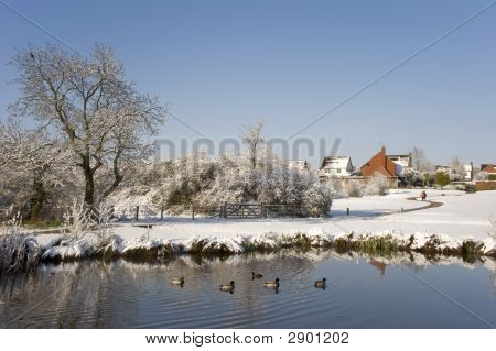 A snow covered rural landscape in the countryside poster