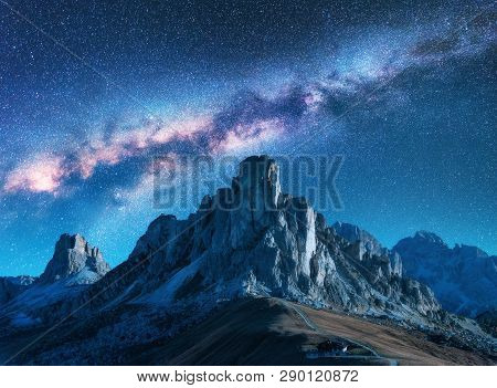 Milky Way Above Mountains At Night In Summer. Landscape With Alpine Mountain Valley, Blue Sky With M