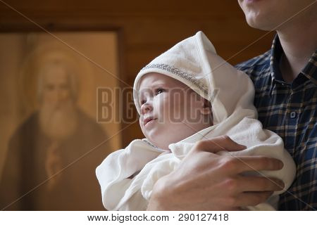Belarus, Gomel, September 17, 2018. Prudkovsky Church. The Baptism Of The Child.the Child Is Held In