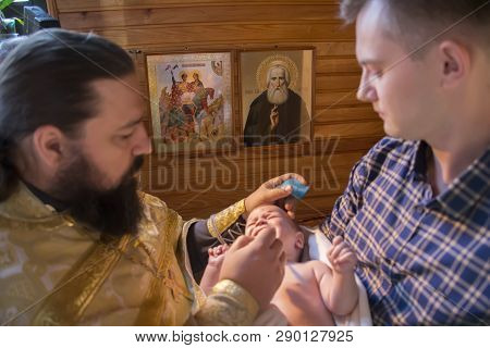 Belarus, Gomel, September 17, 2018. Prudkovsky Church. The Baptism Of The Child.blurred Priest And G