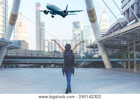 Traveler Women Plan And Backpack See The Airplane At The Airport In The Modern City. Asian Freedom A