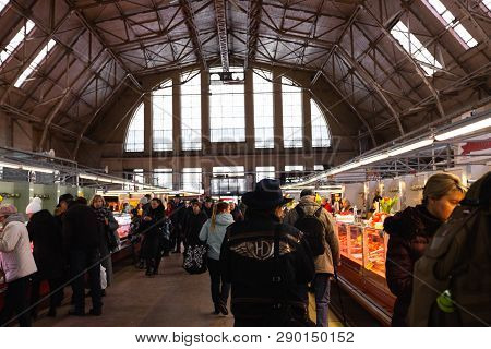 Riga, Latvia - March 16, 2019: Riga Central Market Meat Pavilion, People Buying Fresh Food - Former