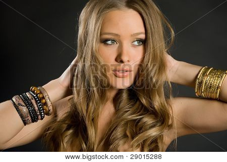 beautiful long-haired girl on a black background