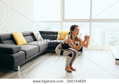 Adult Woman Training Legs Doing In And Out Squat