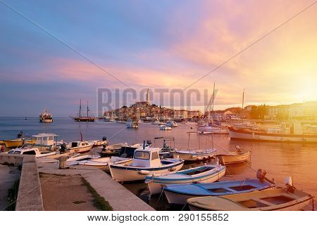 Rovinj, Old Costal Town Of Croatia In Golden Sunrise Light. Motorboats, Boats And Yachts On Water In