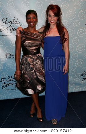 NEW YORK-APR 14: Actors Montego Glover (L) and Sierra Boggess attend the Broadway opening night for 'It Shoulda Been You' at The Edison Ballroom on April 14, 2015 in New York City.