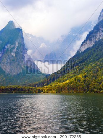 The lake is surrounded by high mountains. Mountain Lake is a fabulous beauty in Bavaria. Konigssee - the cleanest lake in Germany.The concept of active, ecological and photo tourism