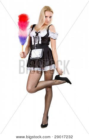 beautiful blonde in a dress of the parlormaid and with a whisk in hands. Isolated on white