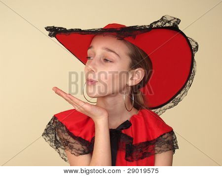 Girl in red sending a kiss