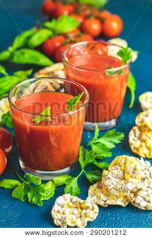 Red Cocktail With Tomato Juice Between Tomatoes, Basil, Parsley And Nutritious Cereal Breads. Delici