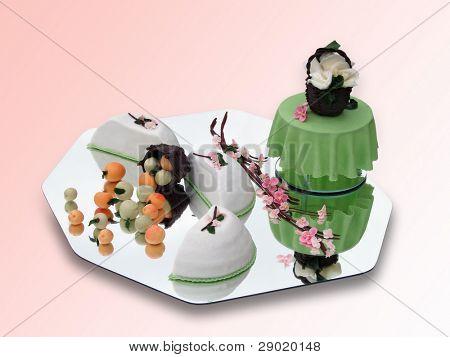Springtime marzipan food arrangement on pink