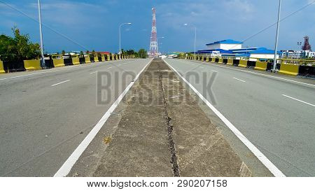 View Of Flyover The Asphalt Road Highway & Striped Yellow Black Traffic Barrier On The Side During S