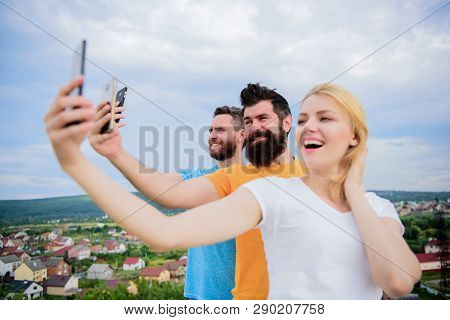 Girl And Man With Mobile Smartphones Communication Online. Selfie Time. Life Online. People Taking S