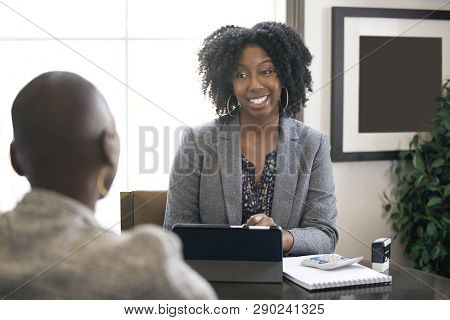 Black Female Businesswoman In An Office With A Client Giving Legal Advice About Taxes Or Financial L