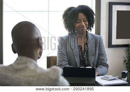 Couple Of Black Female Businesswomen Or Partners Arguing At Work Or A Bossy Manager Doing A Job Inte