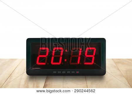 Red Led Light Illumination Numbers 2019 On Black Digital Electric Alarm Clock Face On Brown Wooden T