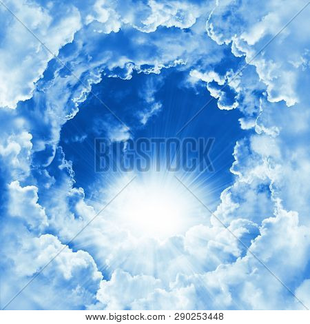 Religion Concept Of Heavenly Background. Divine Shining Heaven With Dramatic Clouds, Light. Sky With