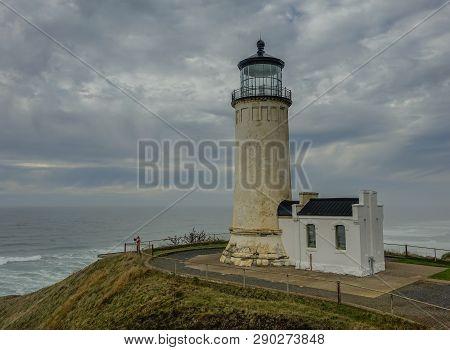 Oregon Coast, Oregon State, Usa: October 11, 2015: Cloudy Day With A Lighthouse On The Oregon Coast