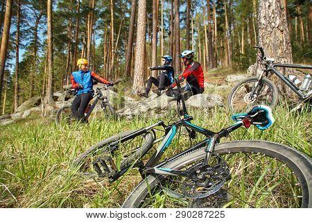 Group Of Cyclists On Halt. Team Outdoors. Mountain Bike