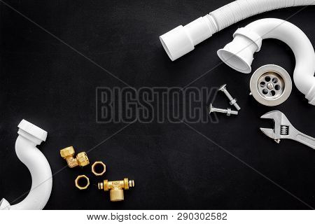 Plumber Profession With Gear And Instruments For Repair Tubes On Black Background Top View Copyspace