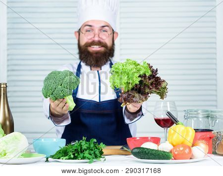 Healthy Nutrition Concept. Bearded Professional Chef Cooking Healthy Food. Healthy Vegetarian Recipe