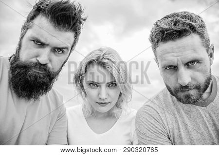 Suspicious Look. Threesome Suspiciously Look Down. Woman And Men Look Confident Sky Background. Stre