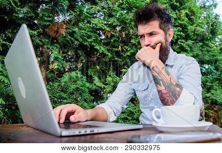 Watching Blog For More Information. Bearded Man Writing New Blog Post In Summer Cafe. Blogger Keepin