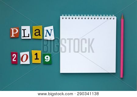 A Word Writing Text - Plan 2019. Open Blank Notebook On Green Background. Planning Concept. Copy Spa