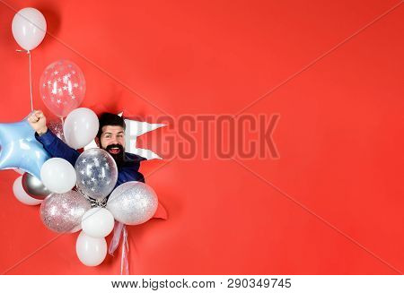 Bearded Man With Balloons Looks Through Hole In Paper. Successful Businessman With Balloons. Birthda