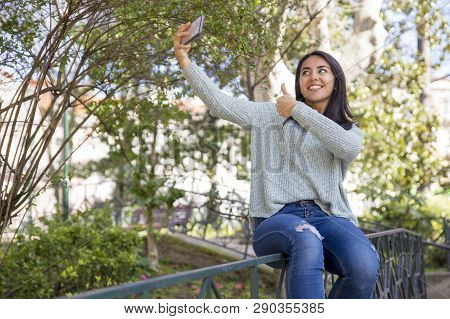 Happy Pretty Young Woman Taking Selfie Photo Outdoors. Beautiful Lady Posing, Using Smartphone And S