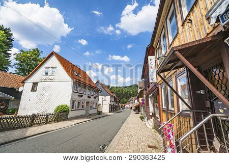 Altenau, Germany - August 12 - 2018: City Street Of Altenau In The Summer With A Forest In The Backg