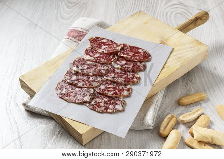 Traditional Iberian Spanish Sausage On Wooden Board