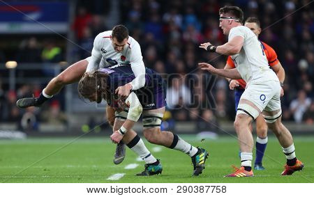 LONDON, ENGLAND - MARCH 16 2019: Jonny May of England attempts to tackle Ben Toolis of Scotland during the Guinness Six Nations match between England and Scotland at Twickenham Stadium.