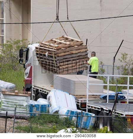 Gosford, New South Wales, Australia - December 18, 2018: Workmen Close Up, Delivering Building Suppl