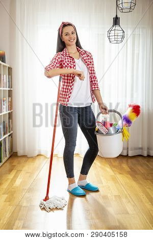 Woman Holding A Floor Wiper And Bucket Filled With Mops And Cleaning Supplies, Doing House Work And