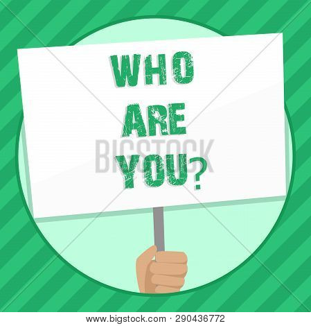Handwriting text writing Who Are Youquestion. Concept meaning Introduce or Identify Yourself Tell your Personal Story Hand Holding Blank White Placard Supported by Handle for Social Awareness. poster