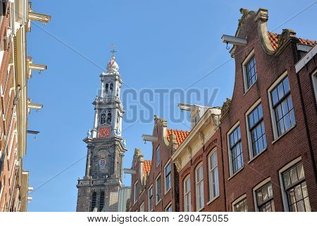 Crooked And Colorful Heritage Buildings, Located Along Bloemstraat Street, With Westerkerk Church Cl