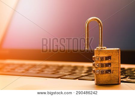 Computer Information Security And Data Protection Concept, Padlock On Laptop Computer Keyboard.  Com