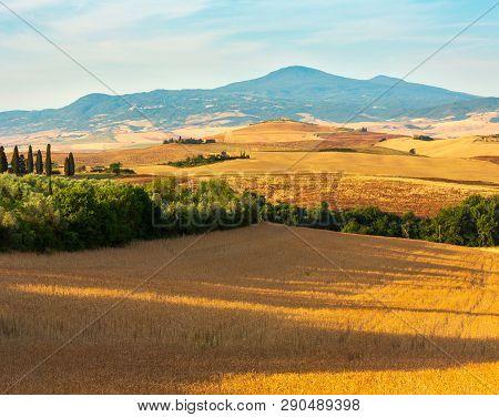 Beautiful Landscape Of Tuscany Summer Morning Sunrise Countryside In Italy.