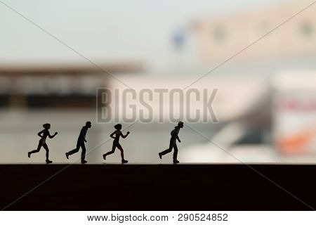 Miniature People Is Running , Silhouette Of A Runner , Health And Lifestyle Concepts.