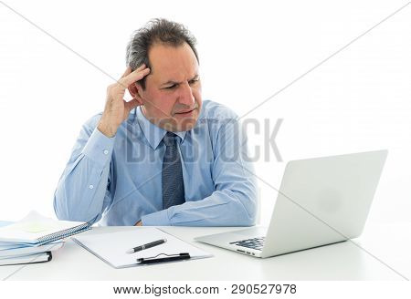 Overwhelmed And Tired Mature Businessman Working At Office Feeling Stressed And Headache